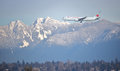 Air Canada And Vancouver`s Northshore Mountains Royalty Free Stock Photos - 86241728