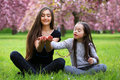 Happy Beautiful Young Woman With Girl In Blossom Park Royalty Free Stock Image - 86242746
