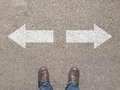Standing At The Crossroad Making Decision Which Way To Go Royalty Free Stock Images - 86301789