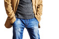 Man In A Yellow Jacket And Blue Jeans Holding Hands In Pockets Royalty Free Stock Photos - 86322228