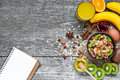 Healthy Breakfast With Fruit Oatmeal, Fresh Fruits, Honey, Egg And Orange Juice With Recipe Book Royalty Free Stock Image - 86335096