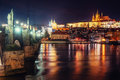 Prague Castle And Charles Bridge In The Night Stock Images - 86335274