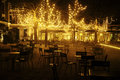 Empty Night Restaurant, Lot Of Tables And Chairs With Noone, Magic Fairy Lights On Trees Like Christmas Celebration Stock Image - 86349481