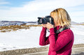 Beautiful Blonde Girl With A Camera To Take Pictures Of Caucasian Mountains Stock Images - 86359404