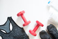 Flat Lay Of Red Dumbbell, Sport Bra, Sneaker, Towel And Bottle Royalty Free Stock Image - 86366786