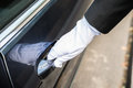 Male Chauffeur Opening Door Of Car Stock Images - 86370064