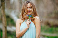 Attractive Model In Blue Dress Smell Snowdrop Flowers In The Spring Forest Stock Photography - 86371212