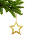 Golden Christmas Star On Green Tree Branch Isolated On White Royalty Free Stock Image - 86377156