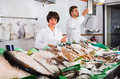 Two Sellers Posing Near Display With Frozen Fish Stock Photos - 86393013
