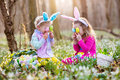 Kids On Easter Egg Hunt In Blooming Spring Garden Royalty Free Stock Photography - 86393877