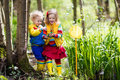 Children Playing Outdoors Catching Frog Stock Images - 86394134