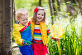 Children Playing Outdoors Catching Frog Stock Images - 86394234