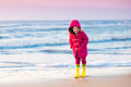 Child On North Sea Beach In Winter Royalty Free Stock Photos - 86394518
