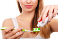 Woman Applying Toothpaste On Her Toothbrush Royalty Free Stock Images - 86403329