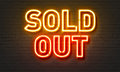 Sold Out Neon Sign On Brick Wall Background. Stock Photography - 86413872