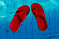 Red Flip-flops Floating In A Swimming Pool, A Top View Stock Photography - 86446662