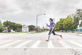 Woman Jogging And Crossing The Road On Zebra In Chicago Royalty Free Stock Photo - 86470245