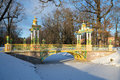 Ancient Colourful Chinese Bridge In Aleksandrovsky Park Of Tsarskoye Selo In The Cloudy November Afternoon. St. Petersburg, Russia Royalty Free Stock Photography - 86502547