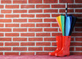Rubber Boots With Umbrella Stock Photos - 86510913