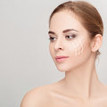 Spa Portrait Of Woman With Arrows On Her Face On Grey Background Royalty Free Stock Image - 86531686
