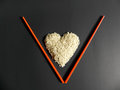 White Rice Heart Placed Letter V Stock Image - 86543441