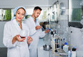 Two Researchers In White Coat Checking Wine Acidity In Laboratory Stock Photography - 86594552