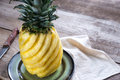 Pineapple On The Plate On The Wooden Background Royalty Free Stock Images - 86605289