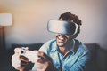 Concept Of Technology,gaming,entertainment And People.African Man Playing Virtual Reality Glasses Video Game While Stock Photos - 86624823