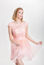 Beautiful Blond Woman In A Pink Cocktail Dress Dancing And Havin Stock Photography - 86654732