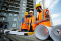 Proofing Construction Blueprints With Supervisor Royalty Free Stock Photography - 86659257