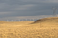 Wind Turbines And Power Line In Yellow Field, Meadow, Before Rain. Wind Farm. USA Royalty Free Stock Photo - 86683905