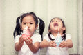 Two Asian Little Girl Having Fun To Blowing Birthday Cupcake Stock Images - 86705314