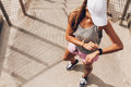 Female Runner Looking At Smart Watch Heart Rate Monitor Royalty Free Stock Photography - 86719557