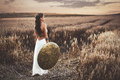 Back View Of Girl Holding Shield Among Grass In Field. Stock Image - 86762931