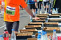 Marathon Running Road Race, Runners Hand Taking Food And Drinks On Refreshment Point, Sport, Fitness And Healthy Lifestyle Royalty Free Stock Photo - 86810415