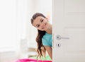 Happy Smiling Beautiful Girl Behind Door At Home Stock Image - 86827551