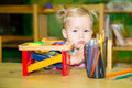 Adorable Child Girl Playing With Educational Toys In Nursery Room. Kid In Kindergarten In Montessori Preschool Class. Royalty Free Stock Photos - 86864268