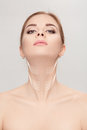 Woman With Arrows On Face Over Grey Background. Neck Lifting Con Royalty Free Stock Photo - 86904165