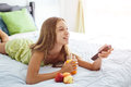Girl Drinking Juice And Watching Tv In Bedroom Stock Image - 86952591