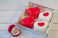 Wedding Ring And Heart Shape Cakes In Box On Table Royalty Free Stock Images - 86967459