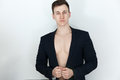 Young Man In Black Suit With Naked Body Stock Photos - 86984973