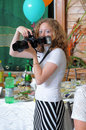 The Girl The Photographer At Restaurant. Royalty Free Stock Photography - 8705377