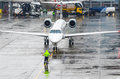Taxiing Aircraft Parking At The Airport After Landing. Man Indicates The Distance To The Stop Royalty Free Stock Photos - 87007488