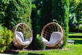 Two Hanging Chairs In Garden On Sunny Summer Day. Stock Image - 87072321