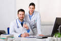 Two Young Doctors In White Coat Stock Photos - 87116253