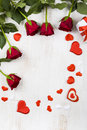 Frame Of Red Roses And Hearts On A Wooden Background. Royalty Free Stock Images - 87141399