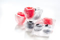 Ice Cubes With Frozen Berries On White Background Stock Photos - 87189123