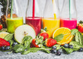 Various Colorful Beverage In Bottles With Fresh Organic Ingredients .Healthy Smoothies Or Juice With Fresh Fruits, Berries And Veg Royalty Free Stock Photo - 87266625