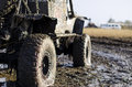 Off-road Car In A Puddle Making Mud Splashes. Stock Images - 87281294