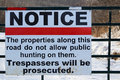 No Trespassing Or Hunting Sign On A Gate Royalty Free Stock Image - 87292346